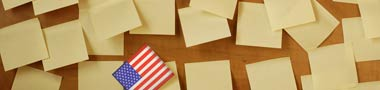 Illustration of US Flag in a pile of office sticky notes