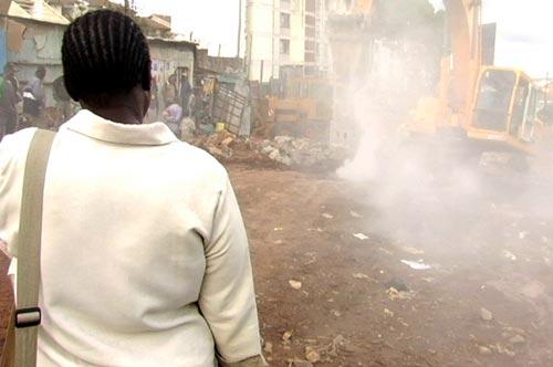 Good Fortune: Silva Adhiambo watching a bulldozer moving into Kibera