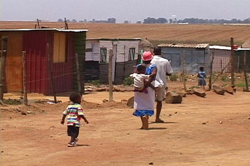 Promised Land: A family walking in South Africa
